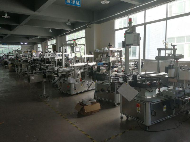 Aplicador de etiquetas de etiquetas adhesivas de propiedades de bebidas de China, provedor de máquina de etiquetaxe de etiquetas automáticas