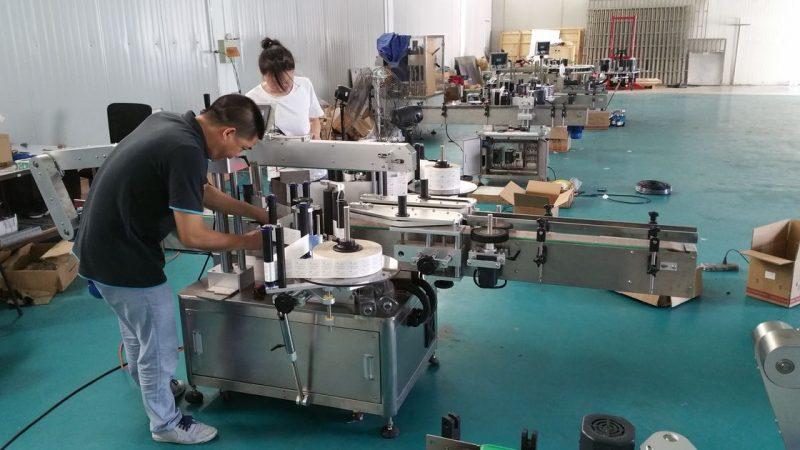 Proveedor de China máquina de etiquetaxe de botellas de auga personalizada, máquina de etiquetaxe automática de bancos para dobre caras
