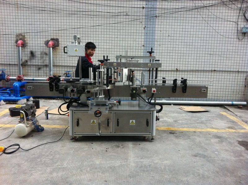 China Máquina de etiquetaxe de botellas redondas adhesivas automáticas para provedor de botellas de mascotas dianteiras e traseiras
